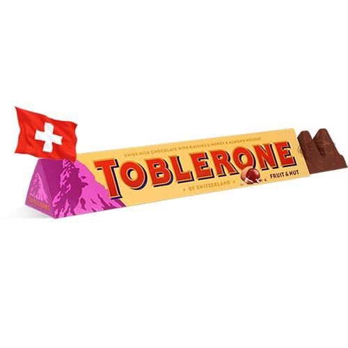 Шоколад молочный с изюмом и мендальной нугой Toblerone 100g Швейцария